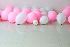 Pink and white balloon on floor Royalty Free Stock Photo