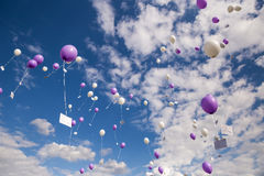 Pink and White Balloons with Postcards Flying in Sky. Germany Royalty Free Stock Photos