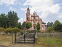 Pink and white baroque church of saint Mary Magdalene in Marenice, Czech Republic, sunny summer day, vibrant color royalty free stock image