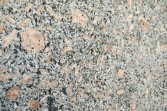 Pink, white and black granite rock background image. With shallow focus royalty free stock image