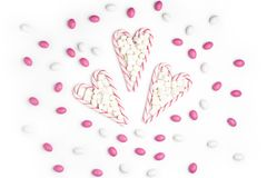 Pink and White candies and lollipops Top view White Background V. Pink and White candies and lollipops in the form of heart Top view White Background Valentine`s royalty free stock photos