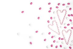 Pink and White candies and lollipops Top view White Background V. Pink and White candies and lollipops in the form of heart Top view White Background Valentine`s royalty free stock images