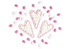 Pink and White candies and lollipops Top view White Background V. Pink and White candies and lollipops in the form of heart Top view White Background Valentine`s Stock Images