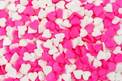 Pink and white candy heart sprinkles background Stock Photo