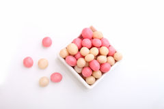 Pink and white candy in a round white plate Royalty Free Stock Photos