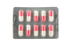 Pink and white capsule in blister pack Royalty Free Stock Image
