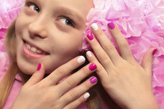 Pink white children`s manicure. Pink white children`s manicure for the girl with the flower Stock Images