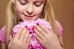 Pink white children`s manicure . Stock Photography