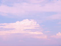 Pink and white clouds in blue sky. Unusual shaped pink and white clouds in a blue sky Stock Image