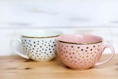 Pink and White Cup with Dots stock photography