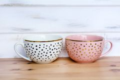 Pink and White Cup with Dots royalty free stock images