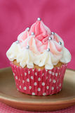 Pink and white cupcake. Decorated with silver dragees Royalty Free Stock Photo