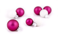 Pink and white decorations. Pink and white christmas balls or decorations, on  a white background, with shallow depth of field Royalty Free Stock Photos