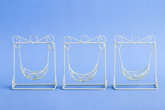 Pink and White Decorative Mini Wrought Iron Swings Stock Images