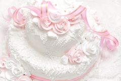Pink and white delicious luxurious wedding cake. With roses Royalty Free Stock Images