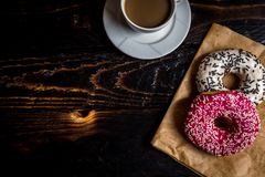 Pink and white donuts with sprinkle stock images