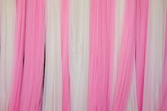 Pink and white fabric backdrop royalty free stock photography