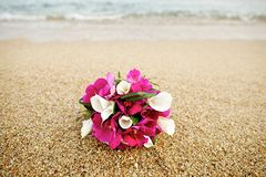 Pink and white flower wedding bouquet on the beach Stock Images