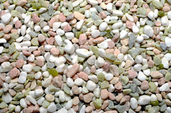 Pink, white and green pebbles gravel background Stock Image