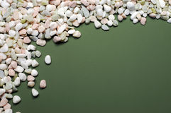 Pink, white and green pebbles gravel background with copy space Stock Images
