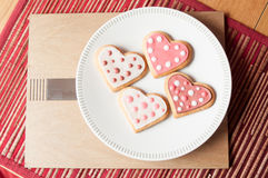 Pink and White Heart Cookies. Beautiful Pink and White Spotty Heart Cookies and Biscuits Royalty Free Stock Photo