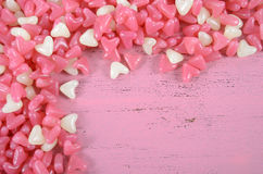 Pink and white heart shape jelly candy background. Stock Photo