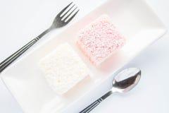 Pink and white lamington sponge cakes Stock Photography
