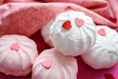 Pink and white marshmallow on a napkin Royalty Free Stock Photo