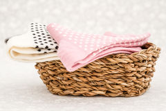 Pink and White Pair of Child Socks in a Straw Basket Stock Photo
