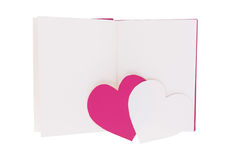 Pink and white paper heart on blank open book isolated on white stock image