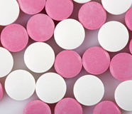 Pink and white pills Stock Image