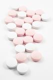 Pink and white pills Royalty Free Stock Images