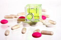 Pink and white pills - balance your health Stock Photos