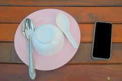 Pink and white plate on wood Stock Photo