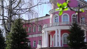 Pink-white public palace tilt down stock video footage