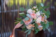 Pink and white roses bunch on stump. The Pink and white roses bunch on stump Stock Photos