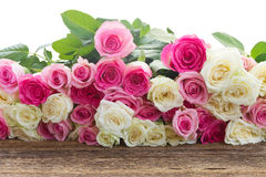 Pink and white  roses. Bunch of pink  and white roses on wooden table  border  on white background Stock Image