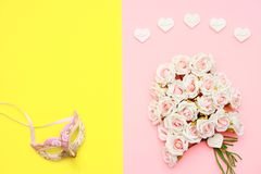 Pink and white roses, heart shape stones and face mask on flat lay paper, happy mothers day. Celebration Royalty Free Stock Photo