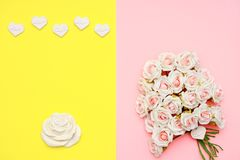 Pink and white roses, heart shape stones and gift wrapped on flat lay paper, happy mothers day. Celebration Stock Photos