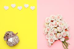 Pink and white roses, heart shape stones and gift wrapped on flat lay paper, happy mothers day. Celebration Royalty Free Stock Photography