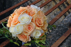 Pink and white roses wedding bouquet. On the rusty well Royalty Free Stock Image