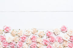 Pink and white roses on white wooden background with empty copys Royalty Free Stock Photography