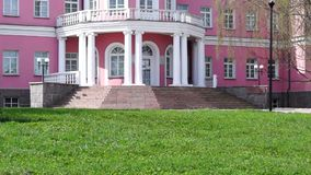 Pink and white social palace entrance tilt up stock video footage