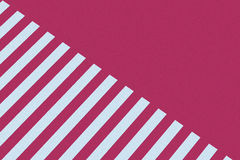 Pink and white striped paper Stock Images