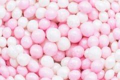 Pink and white sweet sugar balls. Sweet pastel background. Sprinkles sugar texture. Balls pattern. Pink and white sweet sugar balls. Sweet pastel background royalty free stock photos