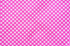 Pink and white tablecloth background. Royalty Free Stock Photography