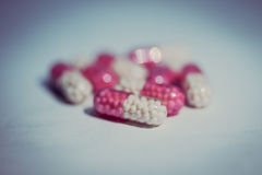 Pink-white tablet Stock Photography