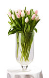 Pink and white tulips bouquet in vase over white Stock Images