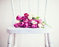 Pink and white tulips on a chair Stock Photography