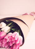 Pink and white tulips over wood Stock Image